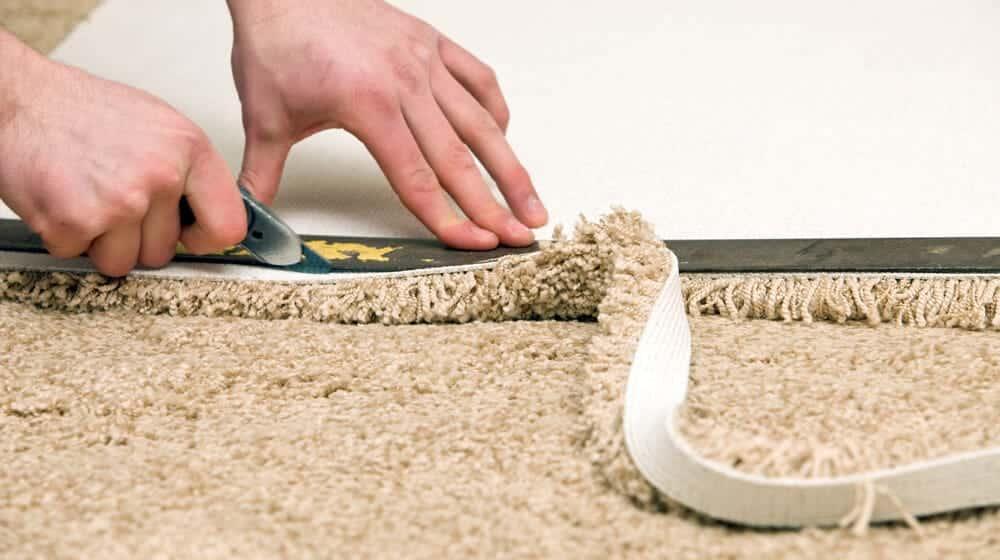 Professional fitters fitting TC Matthews carpet